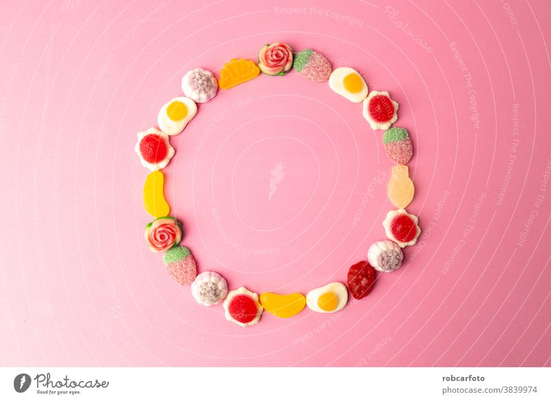 candy, sugar on pink background food colorful sweet dessert closeup confectionery holiday bright orange delicious red group jelly texture unhealthy fruit tasty