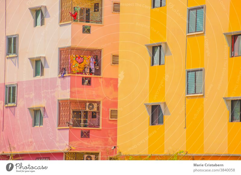 Close up of generic apartment buildings with bright colored walls in Bangkok City anime look colorful buildings urban residential area real estate