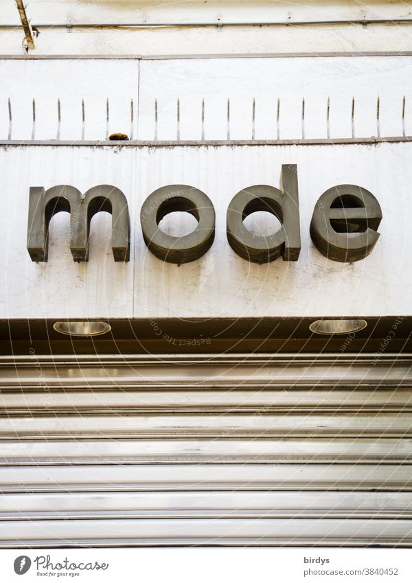 Fashion. closed clothing store, lettering above a boutique Clothing Clothing store Word Letters (alphabet) Retail sector Closed lockdown pandemic Survive
