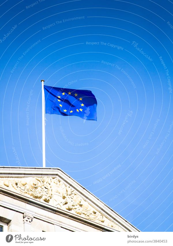 European flag , Flag of the European union waving in the wind against a bright blue sky EU Wind Blue Politics and state European Union historical building