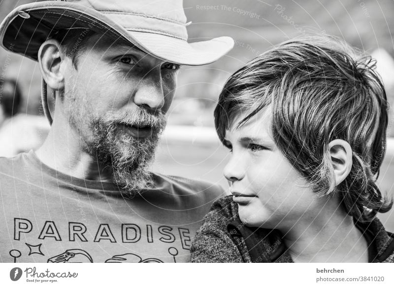 boys in paradise Close-up Sunlight Face Happy Detail Light portrait Boy (child) Child Facial hair Warm-heartedness Safety (feeling of) Trust Day Son Affection