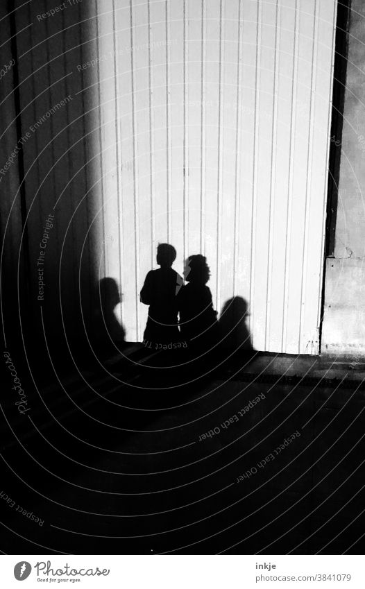 Shadows of several households Black & white photo Light Exterior shot group four individuals Drop shadow White Facade Wall (building) Gloomy Dark Bright