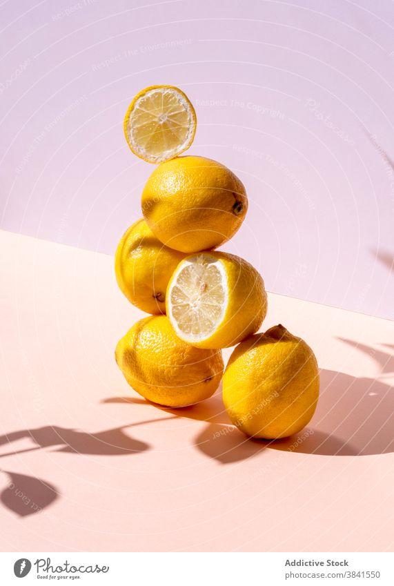 Pile of lemons arranged in studio creative stack composition art fresh sour pile balance pyramid shape natural healthy organic yellow color shadow shade