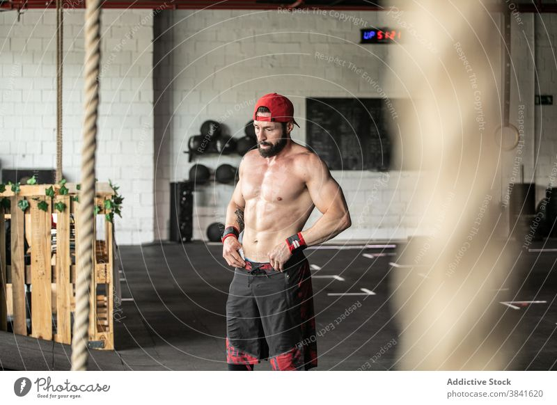 Strong sportsman with naked torso in gym strong muscular determine break training workout male shirtless athlete healthy fit power physical vitality energy