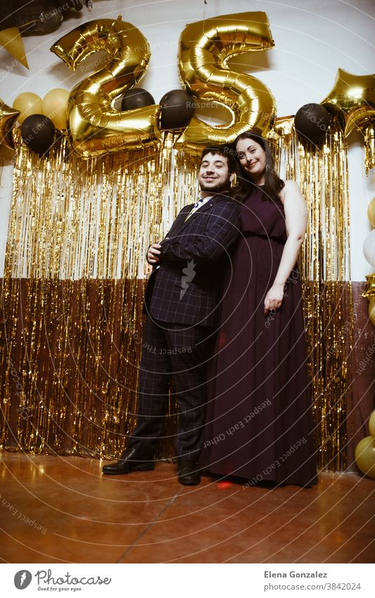 Couple celebrating Christmas or New Year eve. Party time. christmas merry christmas new year couple women excitement together nightlife midnight dancing