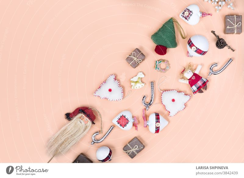 Knitted Christmas tree, New Year baubles, xmas sock, snowflakes on light background  in minimal style. Decorative Christmas ornaments, new year and winter concept with copy space.
