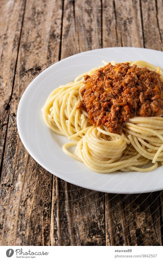 Spaghetti with bolognese sauce on wooden table spaghetti beef cheese food pasta cuisine italian dinner dish homemade italy meat parmesan plate recipe served