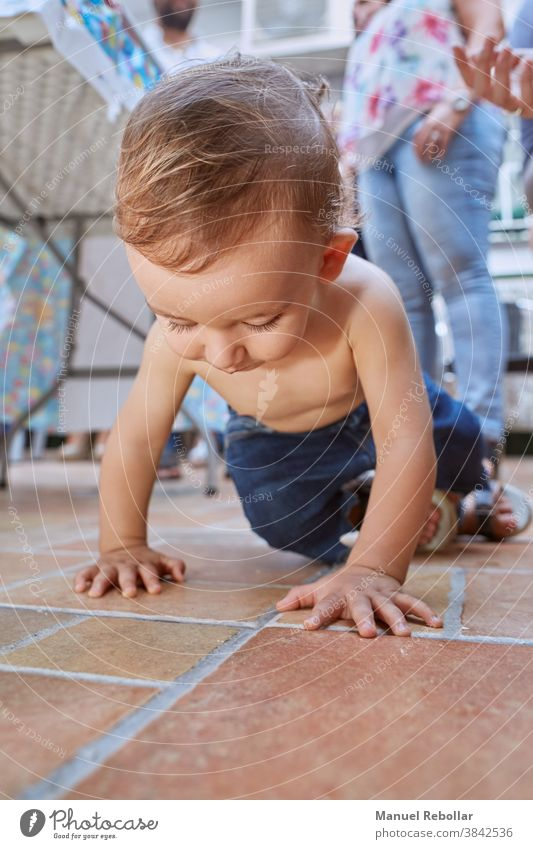 photograph of a crawling baby child kid happy cute childhood toddler boy adorable little beautiful care smiling caucasian infant healthy person girl funny
