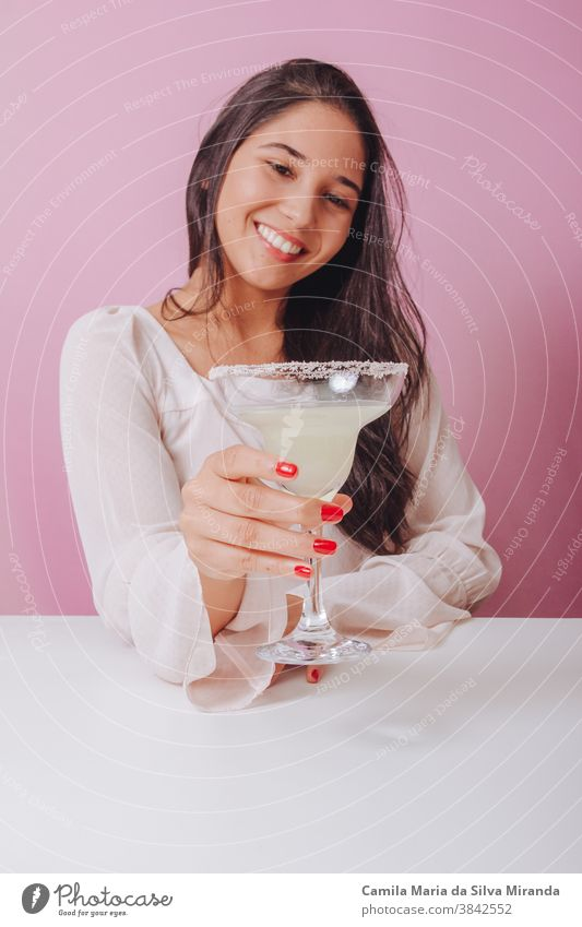 Young woman with margarita drink background beautiful brazilian delicious fashion girl lifestyle party portrait relax smile smiling studio women young