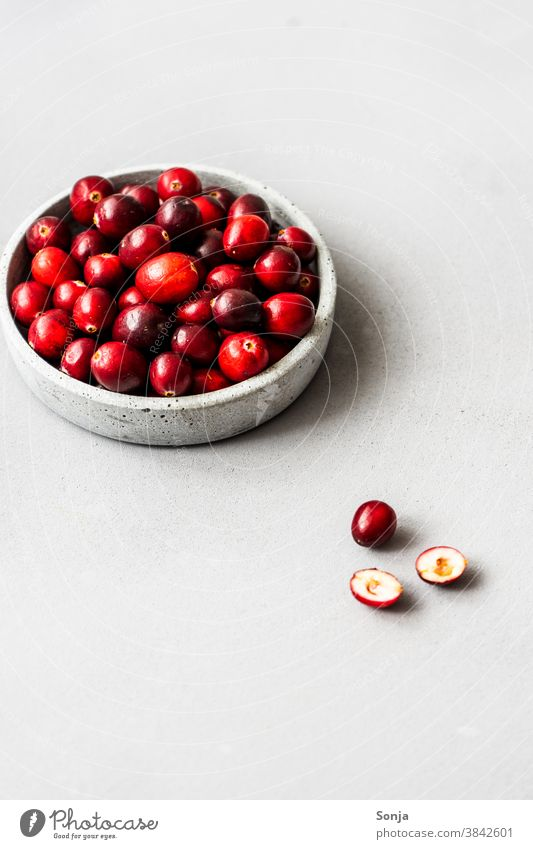 Raw cranberries in a bowl on a grey background. segregated Neutral Background fruit Fresh naturally Delicious Healthy Healthy Eating Organic produce