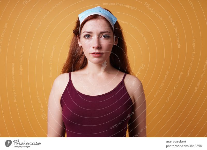 young woman wearing face mask as headscarf - Corona denier Corona deniers corona Mask Headscarf Face mask Corona Refusers COVID coronavirus deny Denier False
