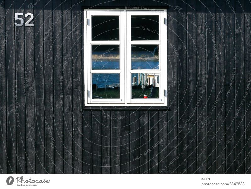 52 with view House (Residential Structure) Hut Wooden house Wooden hut Fishermans hut Black fifty-two board Window pane Reflection Facade Digits and numbers
