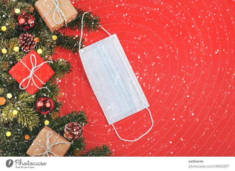 Merry Christmas.Christmas concept background.Protective surgical masks with Christmas gifts with snowflakes christmas santa claus coronavirus