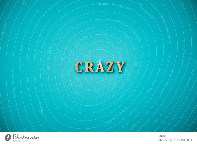 CRAZY | Text on a plain background in turquoise-blue crazy Crazy Go crazy batty gaga Muddled gone bananas high-spirited mad craze sb. crazy about madness
