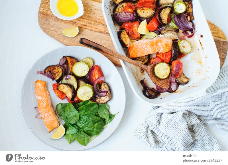 healthy diet food - baked vegetables with salmon meal vegetarian cooking dinner roasted delicious dish lunch fresh onion green vegan tomato tasty red ingredient