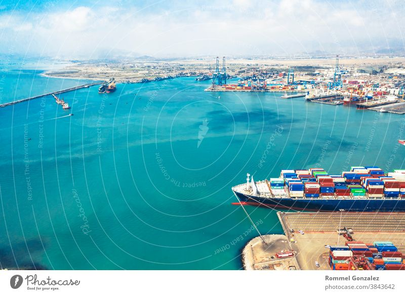 Callao, Lima / Peru - November 4 2020: View of dock and containers in the port of Callao drone view aerial photography aerial view freighters carrying unloading