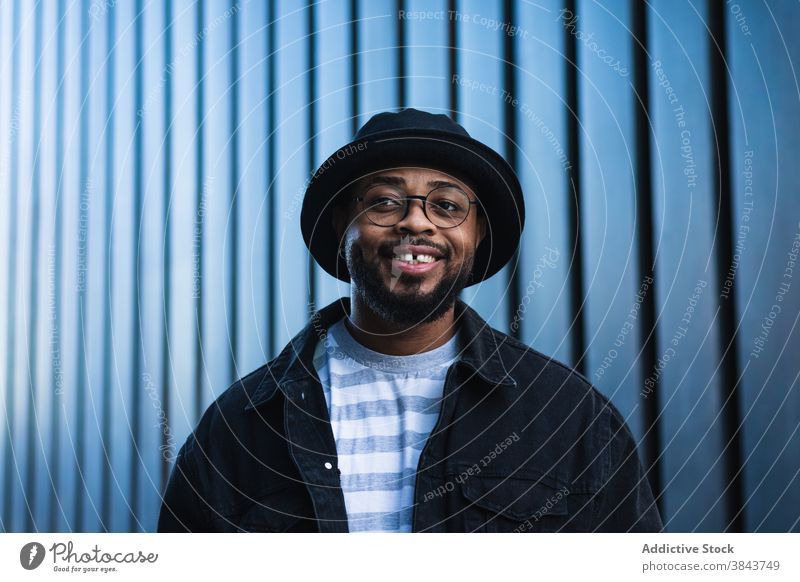 Smiling black hipster man in hat looking away happy trendy cheerful smile beard eyeglasses optimist male african american ethnic outfit style positive joy