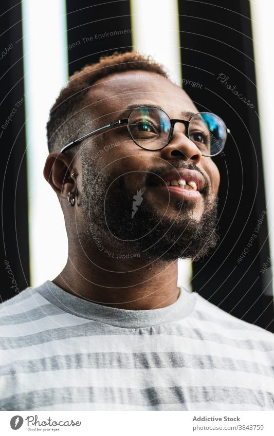 Smiling bearded black man in eyeglasses positive confident casual hipster smile stripe trendy style african american ethnic male modern handsome guy happy
