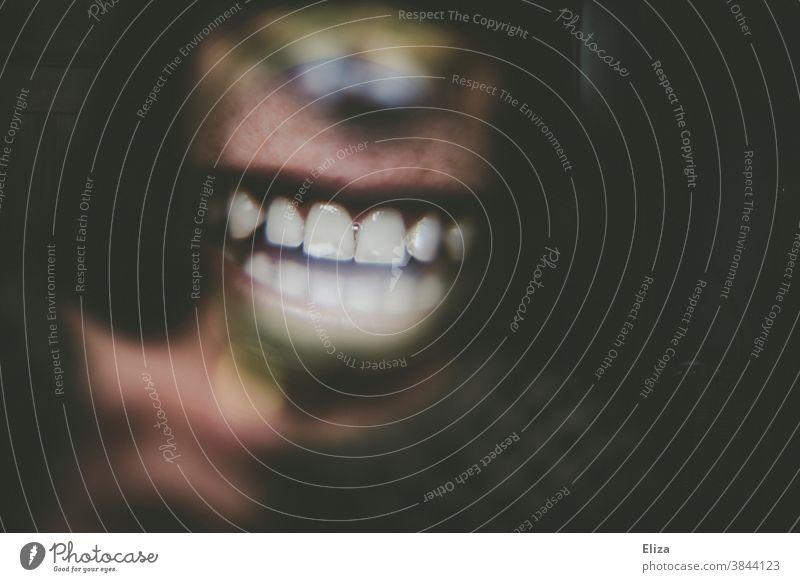 Close up of a laughing mouth and teeth through a magnifying glass Teeth Mouth Laughter Close-up Set of teeth Magnifying glass Woman Dentist Dental care Lips