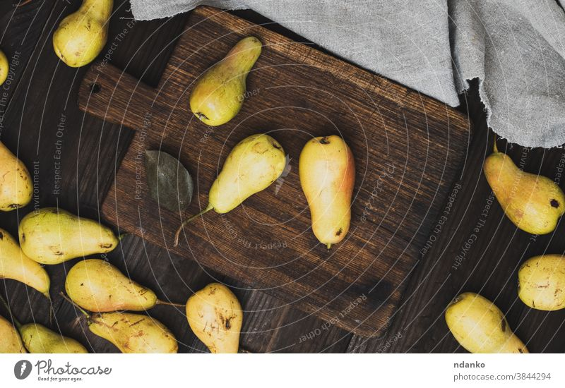 ripe yellow pears on brown wooden cutting board raw rustic season sweet table tasty vegetarian vintage vitamin above agriculture autumn background closeup food