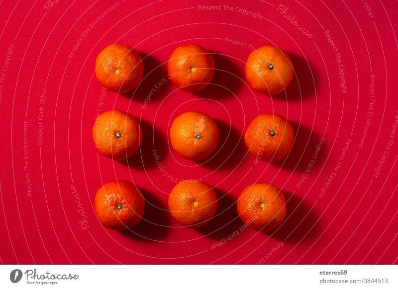 Fresh tangerines in bowl asian blue chinese citrus clementine food fresh fruit healthy juice macro mandarin natural nature new year orange organic piece raw red