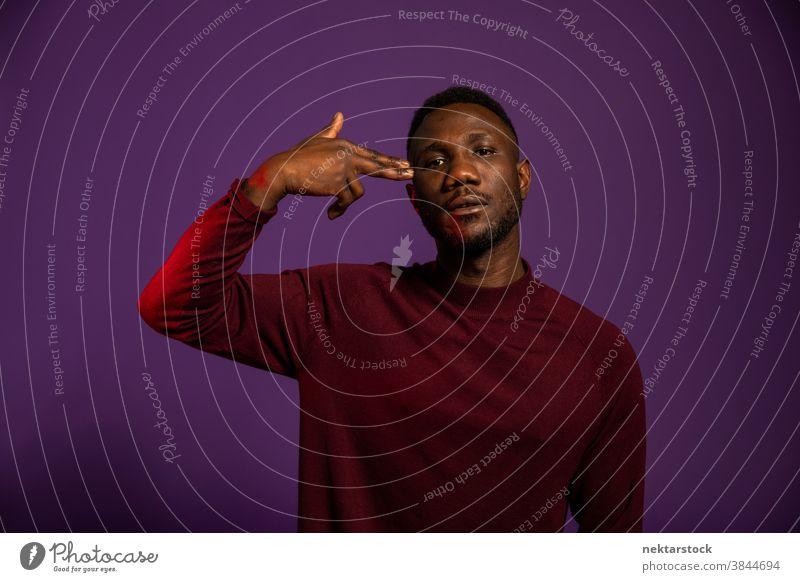 African Man Showing Suicide Hand Gesture man black hand sign shoot me kill me suicide body language hand gesture boredom medium shot finger temple index finger