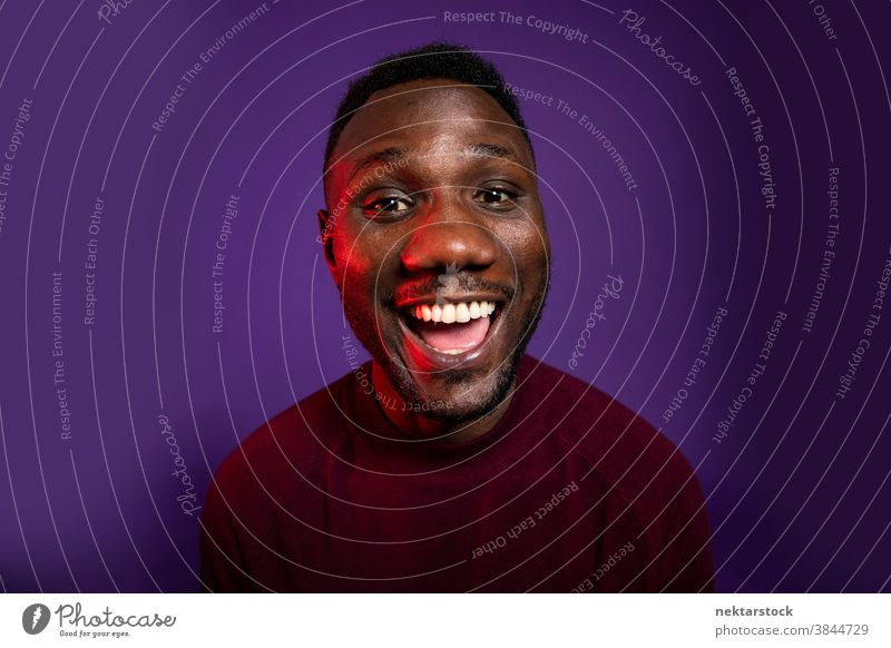 African Man Smiling with Big Smile at Camera man happy black African ethnicity open mouth facial expression happiness medium shot joy toothy smile big smile