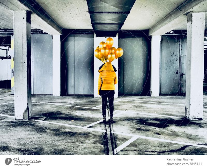 Art, Gold Balloons Yellow balloons Colour photo Underground garage Gray White Black yellow jacket black pants Line Parking garage Stand creatively Creation