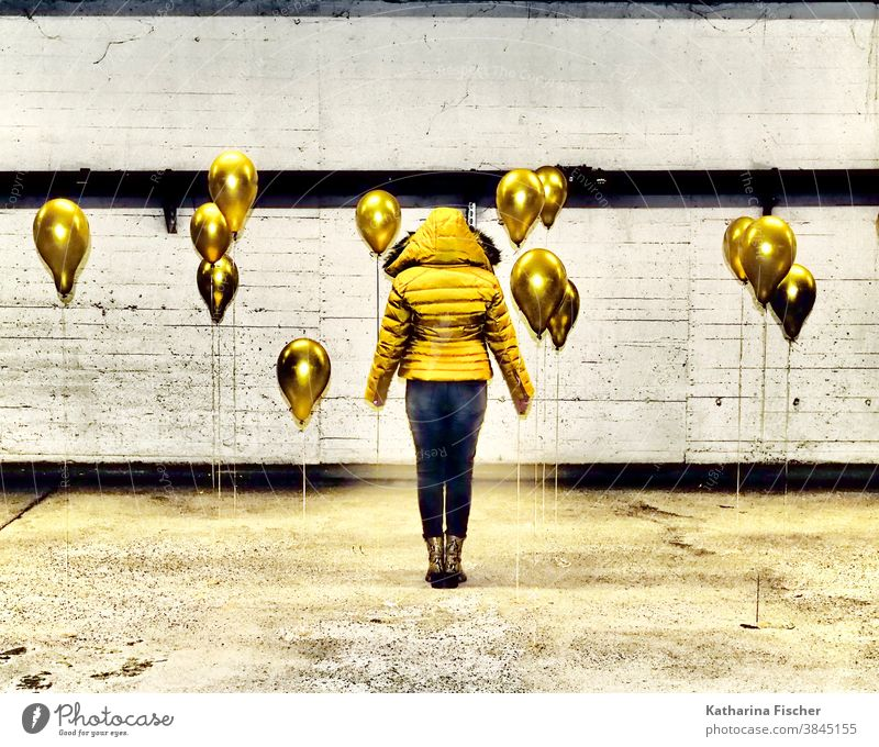 Gold Balloons Yellow balloons Colour photo Underground garage Gray White Black yellow jacket black pants Line Parking garage Art Stand creatively Creation