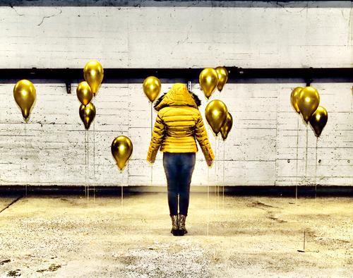 Gold Balloons Yellow balloons Colour photo Underground garage Gray White Black yellow jacket black pants Line Parking garage Art Stand creatively Creation