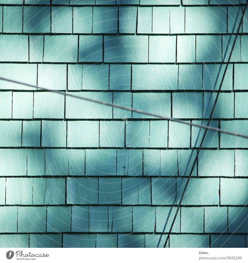 Lifelines #144 wooden shingles Architecture texture Wall (building) sunny Cable light reflex Shadow Turquoise house wall Facade cladding Protection Silhouette