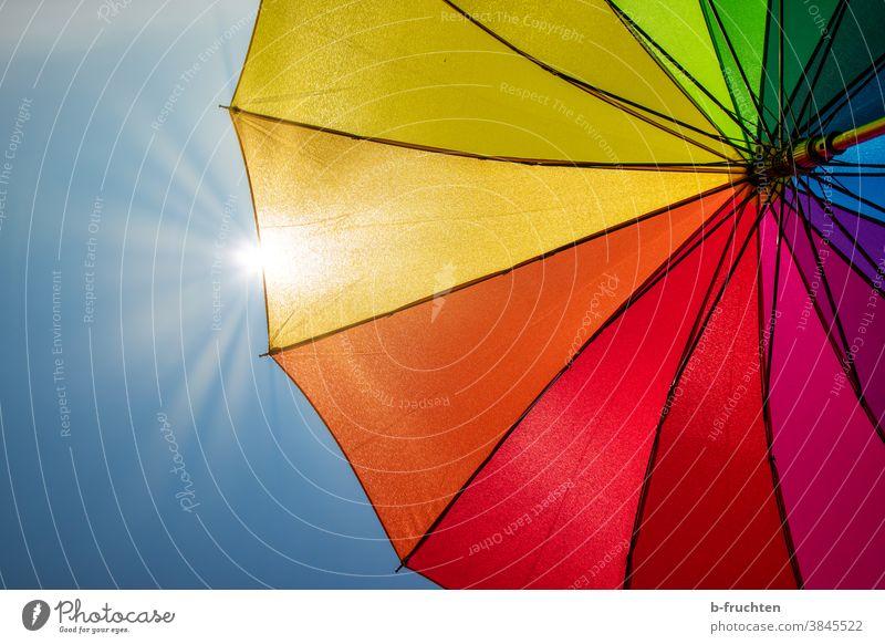 colourful umbrella in sunshine Umbrella variegated Colour Prismatic colors Sky Multicoloured Day Light Sunlight Sunbeam Back-light Sunshade Rain