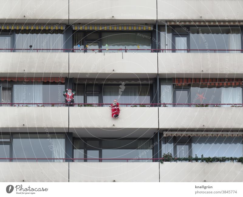 Balcony of a high-rise building decorated with Santa Clauses Decoration High-rise Christmas & Advent Winter Feasts & Celebrations Colour photo background