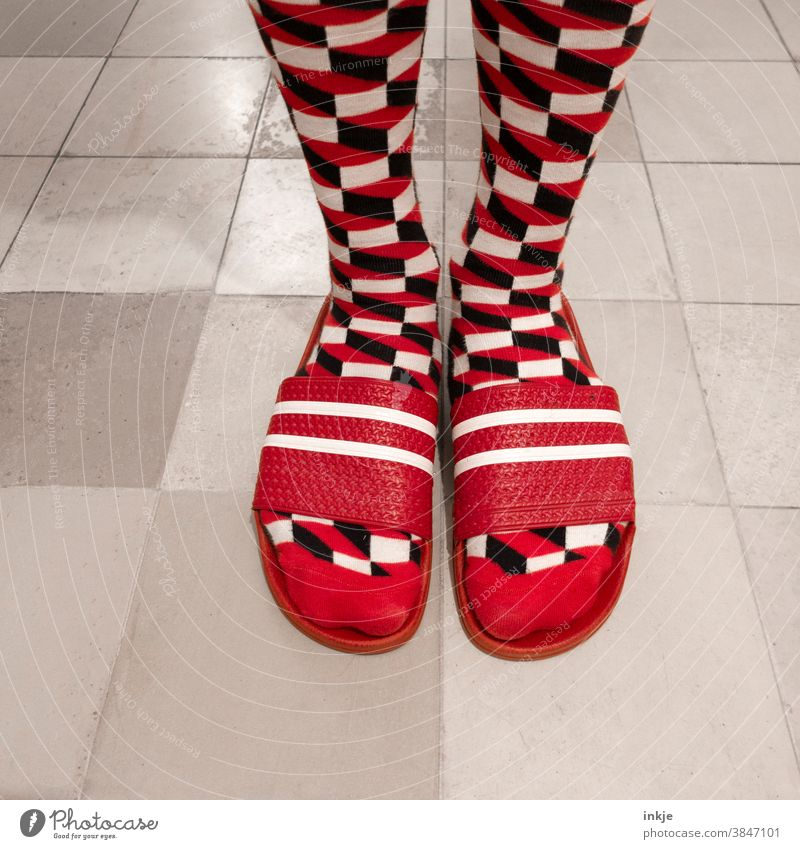 Patterned socks in red bath slippers Colour photo Close-up Bird's-eye view Feet feet Beach shoes Fashion Style Tasteless Exceptional differently Hideous