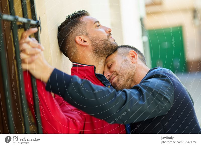 Gay couple in a romantic moment outdoors gay laugh laughing male love homosexual lgbt lgbtq relationship lovers boyfriend people adult happy outside together