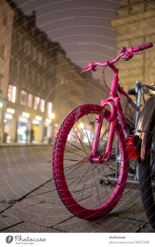 Pink bike parked on street at night and fog Wheel Bicycle pink Tire Road traffic Means of transport Detail Deserted Close-up Parking Profile Munich