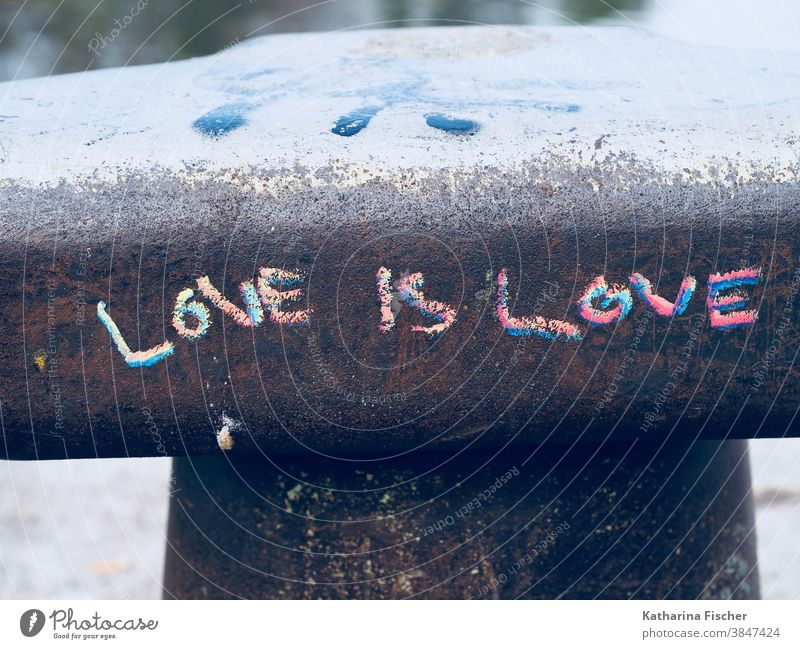 LOVE is LOVE Graffiti Love Emotions Exterior shot Wall (barrier) Wall (building) Colour photo Sign scripture Writing font Chalk drawing Red Blue Gray Day