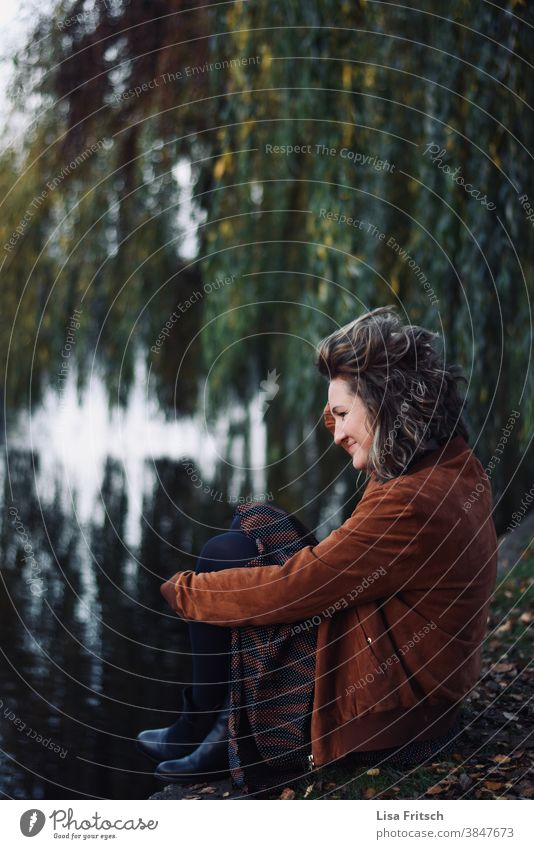 WEEPING WILLOW - WOMAN - AUTUMN Autumn Weeping willow Autumnal Water River sedentary Woman 30 - 45 years Young woman Curl Blonde Modern Reflection in the water