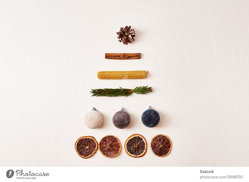 Christmas composition. Christmas tree made of dried fruits, festive balls, cones and fir branches christmas background decor white ornament table holiday xmas