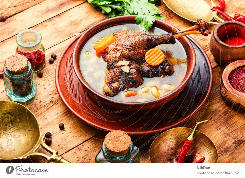 Diet goose soup broth chicken food chicken soup duck soup hot food first course cuisine healthy dinner vegetable spicy cooking dish bowl appetizer carrot lunch