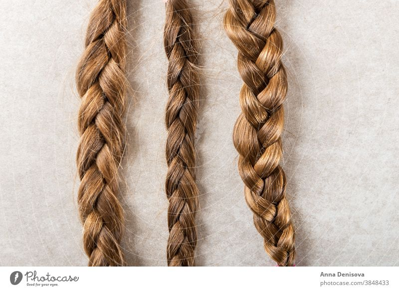 Cut long hair as donation for cancer charity pony tail pigtail donate patient plait concept white braid give cut tress wig chemotherapy care black beauty breast
