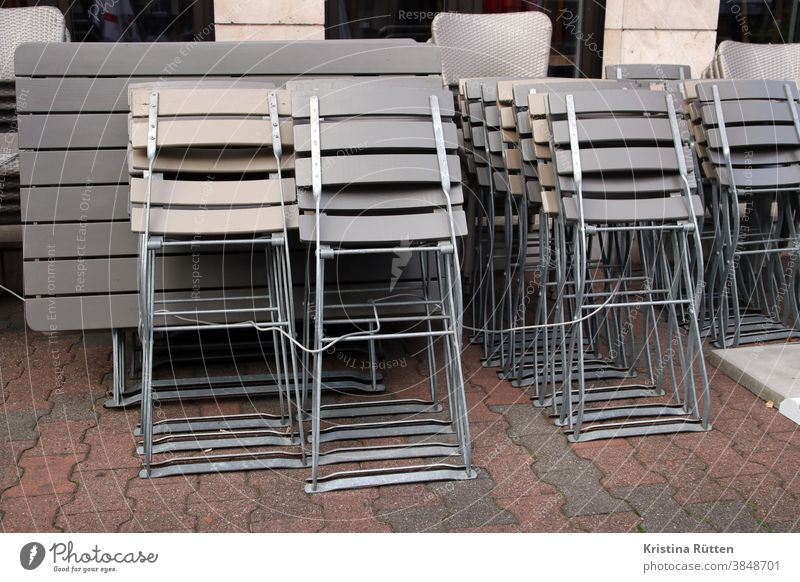 terrace furniture joined together because of lockdown l corona thoughts Terrace chairs tables stacked Closed too closure output lock coronavirus Virus covid19