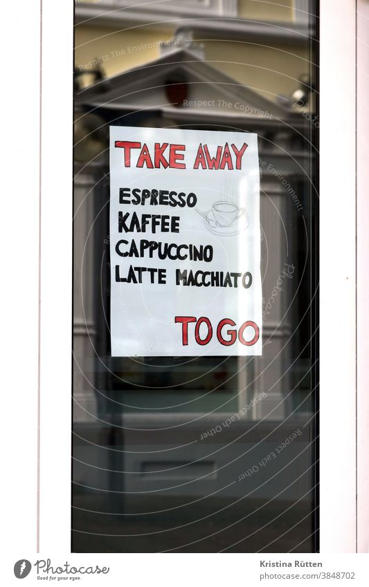 sign with take away offer in the window of a local to go Coffee Espresso Cappuccino Latte macchiato hot drinks In transit out street sale lockdown Gastronomy