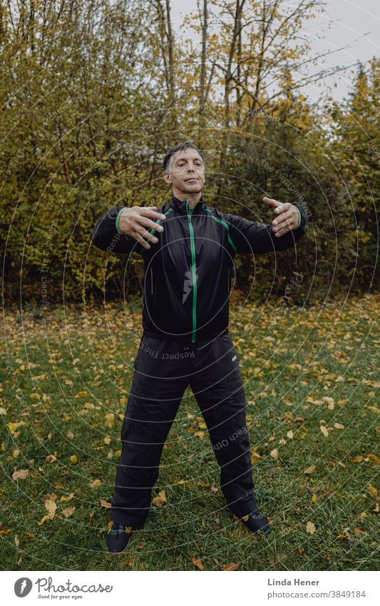 """Exercise """"Standing like a tree"""" while practicing Qi Gong on the meadow Qi gong qi fit Happy contented Contentment Joy vital Sports Meadow Park outdoor area"""