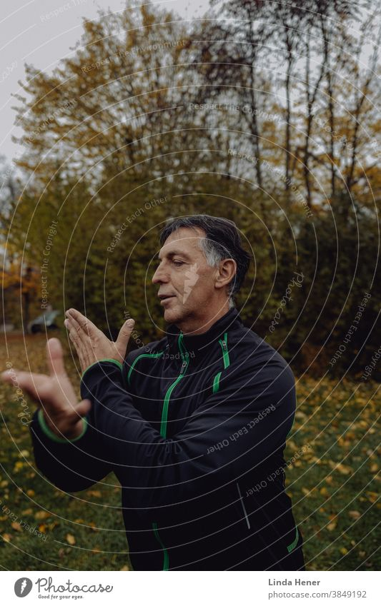 Practice Qi Gong in autumn qi Qi gong Qigong Relaxation Meditation Healthy Wellness Zen Nature Lifestyle Fitness workout Exterior shot Calm pretty Body Sports