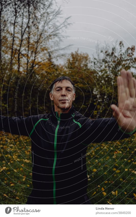 Qi Gong exercise on the meadow in autumn qi Qi gong Qigong Attentive Calm Serene Nature Day Exterior shot Practice Relaxation Zen Healthy Meditation Wellness