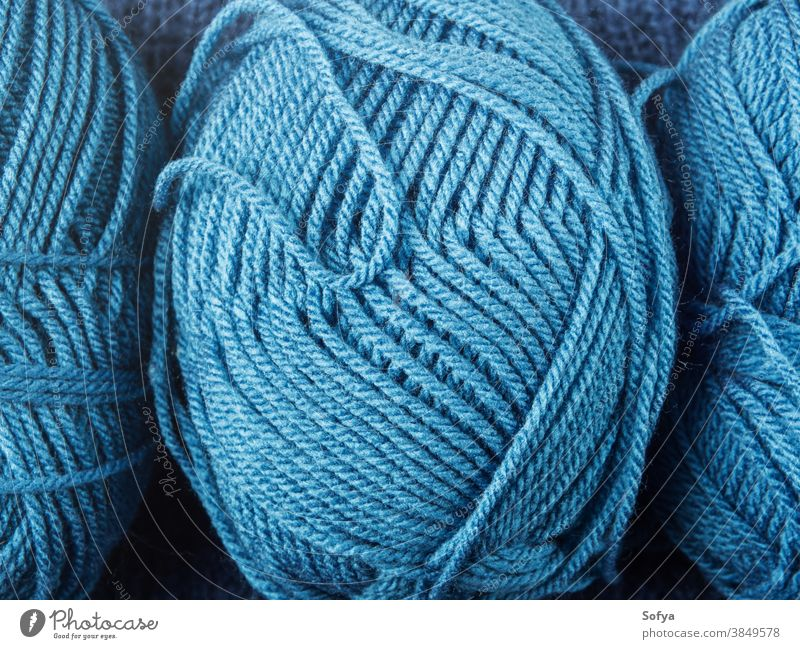 Blue wool knitting yarn texture background blue winter macro needlework hobby needles knitwear soft home tools care pastel above sewing comfort ball fashion