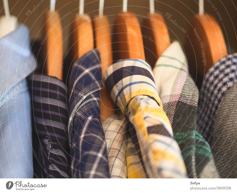 Man's closet. Hangers with shirts closeup. Male wardrobe man clothing male hanger winter autumn fall fashion tidy clothes wear purge clean build home old