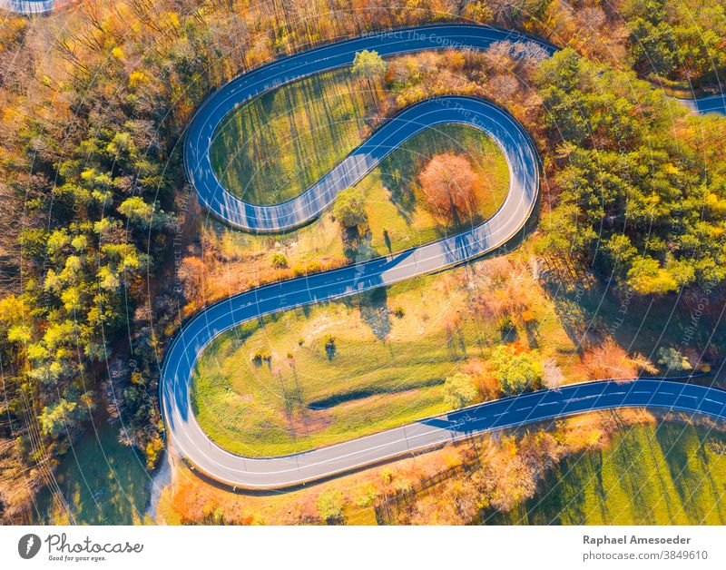 Curvy road up the mountain, aerial view on autumn evening above architecture asphalt color colorful colors construction curve curvy destination drive fall