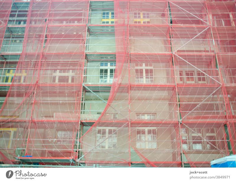 Greener living, construction site with reddish scaffolding Facade Construction site Scaffold Covers (Construction) Protection Authentic Structures and shapes